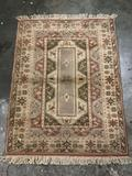 Vintage hand made C. Milar Turkish rug with fringe, natural tones with brown, tan and green
