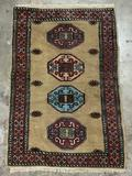 Vintage hand made wool rug with trimmed fringe and geometric designs