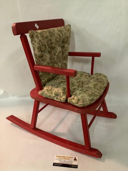 Vintage red painted wood doll size rocking chair with cushions, approximately 19 x 12 inches