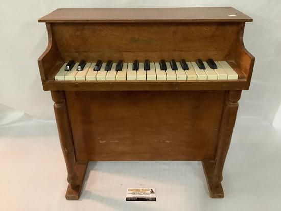 Doll size Schoenhut wooden toy piano, actually plays, approx 20x20x10 inches.