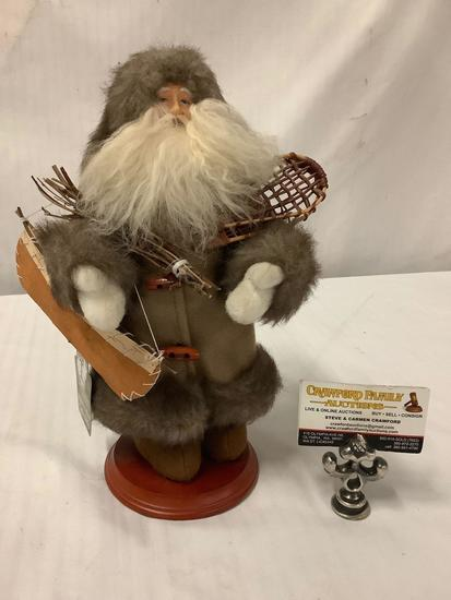 Santa?s Workshop handcrafted collectible , Santa Claus in snow gear with snow shoes/ canoe, with