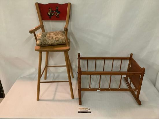 Lot of 2 vintage wooden doll furniture high chair with painted back and rocking cradle crib, approx
