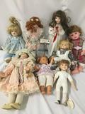 Lot of eight porcelain dolls from makers like Heritage Mint, Moments Treasured, and others. Includes