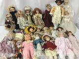 Twenty three ceramic, porcelain and soft vinyl dolls From makers like Cardinal, Danae, Showstoppers,