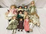 11x Porcelain, Vinyl, and Composite dolls. Largest measures approximately 20x10x4 inches.