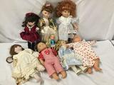 8x porcelain, vinyl, and plastic dolls. Bratz and more. Largest doll measures approximately 20x11x4