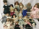 Eighteen porcelain and ceramic dolls from makers like Westminster, Ashley Belle, Court of Dolls, and