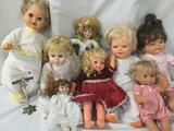 Lot of eight ceramic, soft vinyl, and porcelain dolls by makers like Heritage Mint and Mattel. JRL