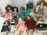 Eleven porcelain dolls, from makers like JCPenny and Eugene Doll Co. Largest doll is approx.