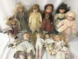 Ten porcelain dolls from makers like Heritage Mint. Largest doll is approximately 17x7x3 inches. JRL