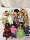 Nine multicultural porcelain dolls, including three hats and three shoes. From makers like House of
