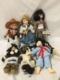 6x composite, porcelain, and plastic dolls. Inuit, Japanese, Chinese, and cowboys. Largest doll