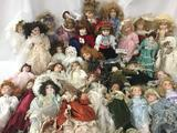 Thirty one porcelain and ceramic dolls, makers include Geppeddos, Brinns, Heritage Mint, Collectors