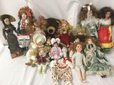 Fifteen unmarked porcelain and composite dolls, with one Dakin teddy bear. Largest doll is approx.