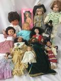 Thirteen porcelain, composite, and vinyl dolls. Makers such as Berjusa included. Largest doll