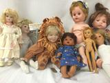 Eight vinyl, ceramic, and porcelain dolls from Duckhouse, TEC, Cititoy, Heritage Dolls, and more.