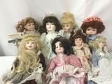 Eight porcelain dolls by the Antique Guild and others. Largest doll approx. 8x19x3 inches. JRL