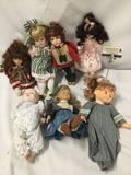 7x porcelain, composite and vinyl dolls. Hand made and more. Largest doll measures approximately