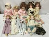 12x porcelain and vinyl dolls. Mann and more. As Is. measures approximately 16x9x5 inches.