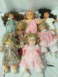 Seven porcelain and vinyl dolls from Susan Wakeen Doll Co, ZAPF Creation, and Gi-Go Toys. Approx