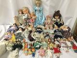 Huge lot of vinyl, plastic, and porcelain dolls from Russ, hasbro and others. Approx. 9x27x4 inches.