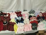 A collection of infant/child/doll clothing by Petite Amie, Youngland, and others. Approx.
