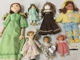 Seven vintage porcelain and handmade cloth dolls from JC Toys and others. JRL