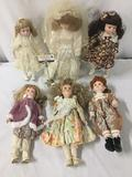 Six unmarked vintage porcelain dolls, one made by Westminster. Approx. 7x19x4 inches. JRL