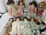 Nine vintage porcelain dolls, several of which are from JCPenny. Approx. 9x17x3.5 JRL