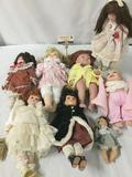 Eight vintage ceramic and porcelain dolls from Seymour Mann, JCPenny, Morning, and Rich Imports. JRL