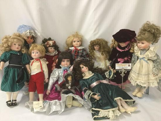 Eleven porcelain, vinyl, and composite dolls from makers like Geppeddo, Goebel, Duck House, Brinns,