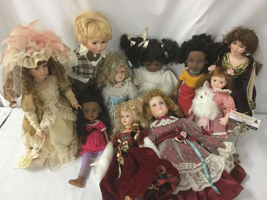 Ten porcelain and composite dolls from makers like G2G and Collectible Memories. JRL