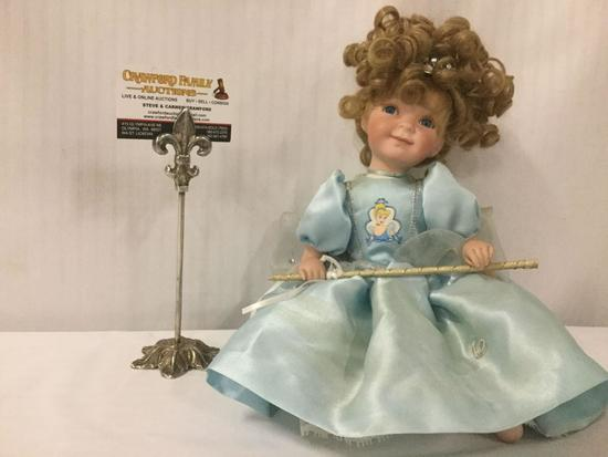 Disney porcelain doll dressed up like Cinderella. Measuring approximately 11x7x6 inches. JRL