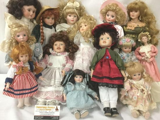 Fourteen porcelain and composite dolls from makers like Swan Collection. Largest doll is approx.