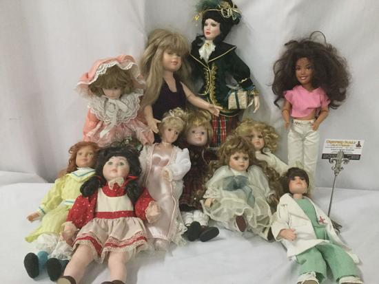 Twelve porcelain, vinyl, and composite dolls from Mattel, Court of Dolls, and others. JRL