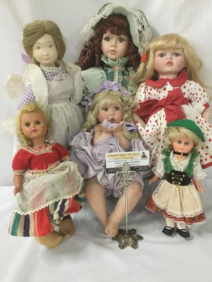 Six composite, vinyl, and porcelain dolls from House of Roses, Traditions, and others. JRL