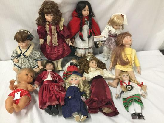 11x porcelain, composite and vinyl dolls. Famosa, Crowne and more. Largest doll measures
