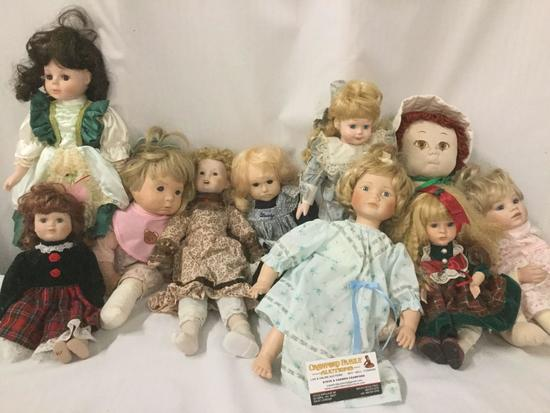 Ten porcelain, composite, vinyl, and handmade cloth dolls from makers like PBJ, Boots Tyner, and