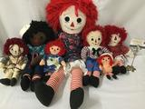 Seven cloth Raggedy Ann and Andy dolls. Largest doll is 34x16x5 Inches. JRL