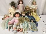 13 porcelain, composite and vinyl dolls. Show stoppers and more. One doll with broken foot. Largest