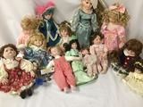 Thirteen porcelain and ceramic dolls from makers like Doll Boutique, DanDee, Design Debut, and