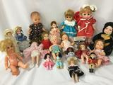 Nineteen composite, porcelain, and vinyl dolls from makers like DanDee, Bradley Dolls, Mattel, Ideal