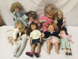 9x vinyl, porcelain and composite dolls. Famosa and more,. Largest doll measures approximately