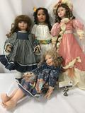 Four big porcelain dolls from makers like Danbury Mint, Traditions Doll Collections, and others. JRL