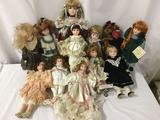 Eleven porcelain dolls and one teddy bear. From makers like Cindy McClure. Largest doll is