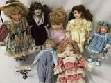 Seven porcelain and composite dolls from makers like Brinns, Geppeddo, and Bessie Pease Cutmann. JRL