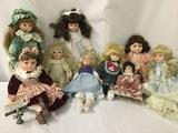 Nine porcelain dolls from makers like Zasan, Hamilton Collection, Westminster, and others. JRL