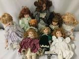 Eight porcelain dolls From makers like Seymour Mann, Heritage Mint, DanDee, Emerald Doll Collection,