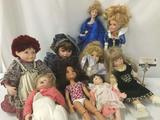 Nine porcelain, vinyl, and composite dolls from makers like Mattel, House of Roses, MGA