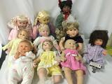 Ten porcelain and vinyl baby dolls from makers like Berenguer, Ideal Toy Co., Paradise Galleries,